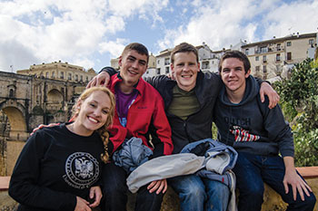 Central students sitting on a bridge while studying abroad in Granada.