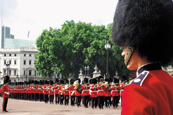 A marching band composed of the Queen's Guard in London, England.